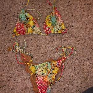 Multi colored cheeky bikini Size Medium